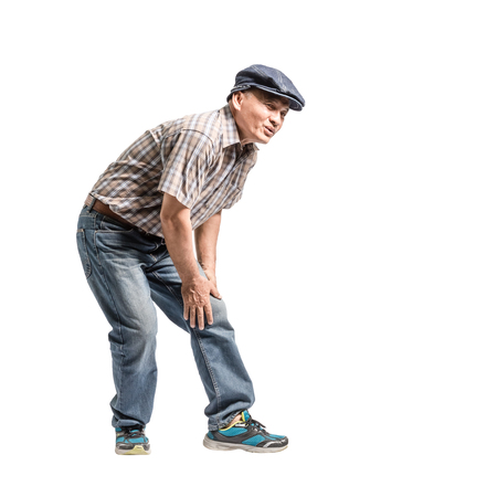 Portrait of a mature man with knee pain. Isolated full body on white background with copy space Stock Photo