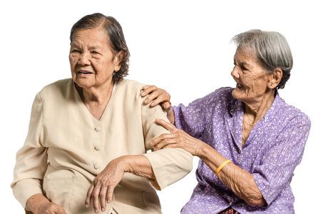 the elderly caregivers: Portrait of senior asian women massage her sister. Isolated on white background