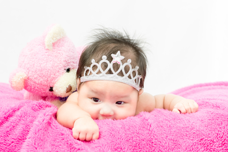 Portrait of adorable baby girl with crown Stock Photo