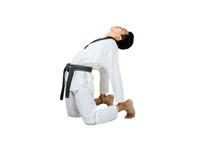 Portrait of an asian professional taekwondo black belt degree (Dan) stretching his body. Isolated full length on white background with copy space and clipping path