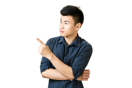 Portrait of a young businessman pointed his hand to left side. Isolated on white background with copy space and clipping path