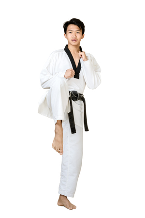 Portrait of an asian professional taekwondo black belt degree (Dan) preparing for kick. Isolated full length on white background with copy space and clipping path