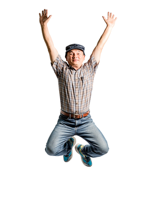 Portrait of a happy mature man jumping. Isolated full length on white background Stock Photo