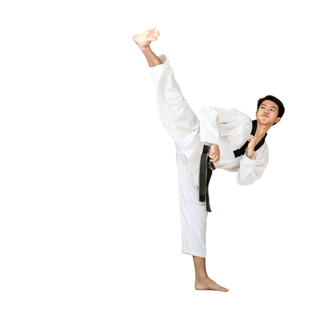 Portrait of an asian professional taekwondo black belt degree (Dan) kick. Isolated full length on white background with copy space Stock Photo