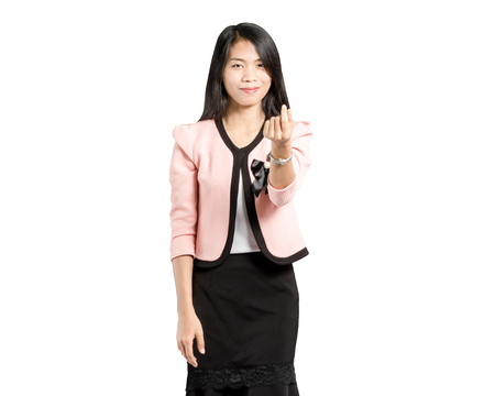 portrait of a beautiful asian businesswoman smiling and showing mini heart sign hands. Isolated on white background with copy space