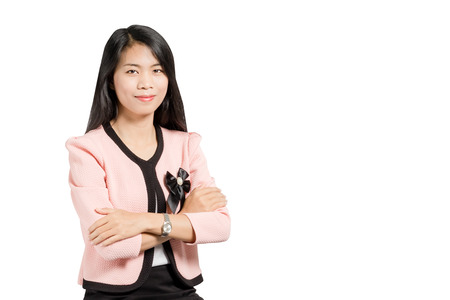 Portrait of a beautiful  asian business woman smiling with arms folded. Isolated on white background Stock Photo