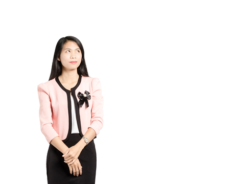 portrait of a beautiful asian businesswoman thinking and looking to top right side. Isolated on white background with copy space Stock Photo