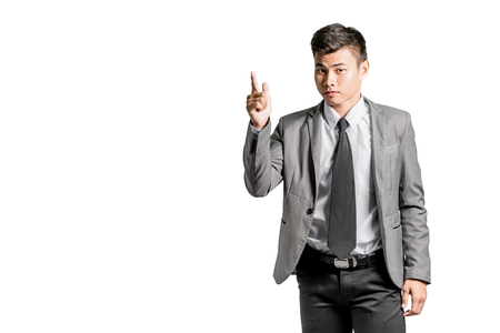 Portrait of a young businessman pointed the finger to left side. Isolated on white background
