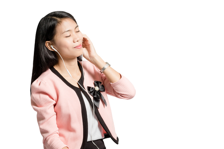 telephone interview: Portrait of a young business woman smiling with earbuds  headphone for listening to music or talking on smart phone. Isolated on white background with copy space and clipping path Stock Photo
