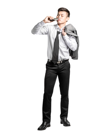 Portrait of an asian business man drinking an alcohol. Isolated on white background with clipping path