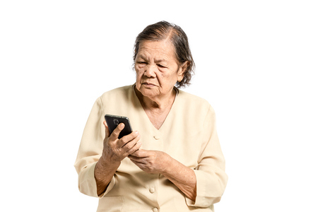 Portrait of a senior asian women looking at smartphone. Isolated on white background