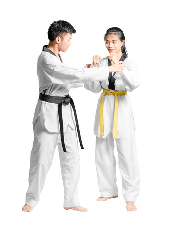 Portrait of an asian man professional taekwondo black belt degree (Dan) teaching to woman's yellow belt degree. Isolated full length on white background with copy space and clipping path Stock Photo
