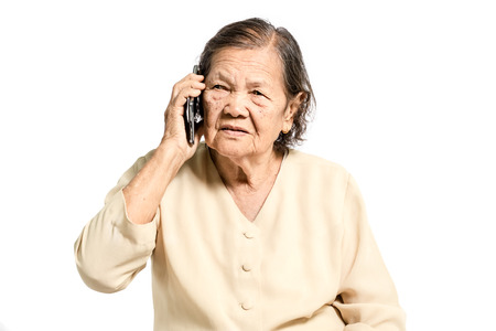 Portrait of a senior asian women talking on smartphone. Isolated on white background with clipping path