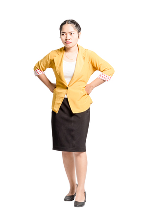 Portrait of an angry asian woman. Isolated full length on white background with clipping path Stock Photo