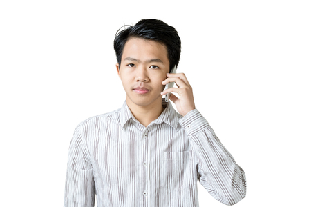 Portrait of a young asian businessman using smart phone. Isolated on white background with copy space and clipping path