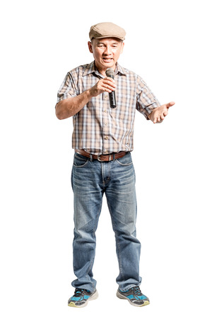 Portrait of a happy mature man presented with microphone. Isolated full lenth on white background with clipping path Stock Photo