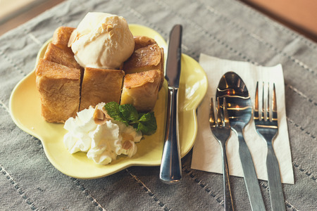 honey tone: Ice cream honey toast on table cloth : Vintage tone