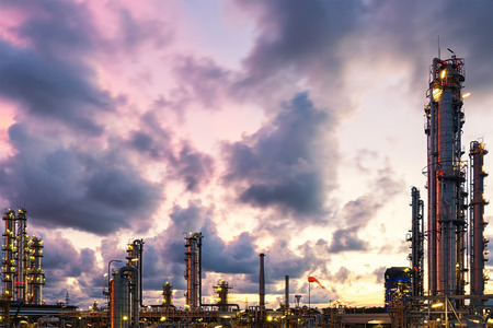 oil and gas industry: Violet and blue twilight sunset scene of oil and gas refinery skyline