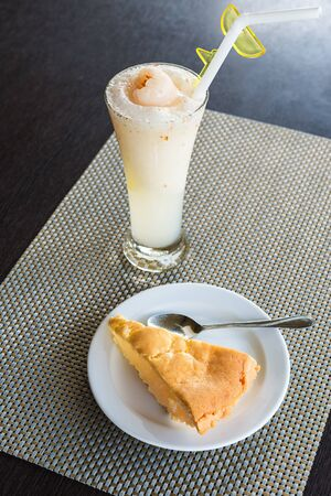 toddy palm: Toddy palm pie with lychee smoothie on wooden table