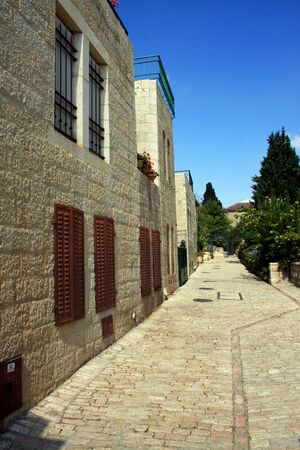 Cobblestone path alongside a row of historic houses in Yemin Moshe, Jerusalem Stock Photo - 5283550