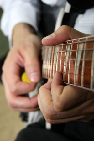 Close Up of a guitarist strumming an acoustic guitar