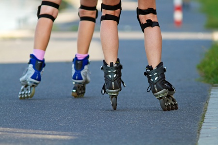 inline skates: Two girls on the roller skates Stock Photo