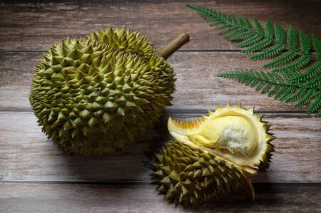 Durian on sack and Delicious fresh Ripe durian tropical fruit on the wooden background, king of fruits in Thailand