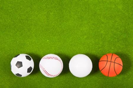 Four balls on green grass