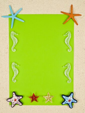 Blank green paper with star fishes