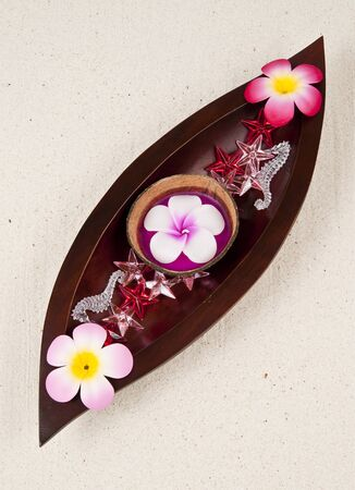 Three flowers in the wooden leaf tray