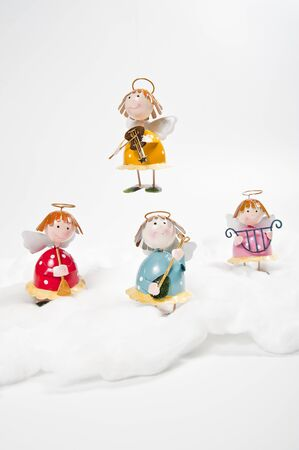 Angels play Christmas song on the cloud photo
