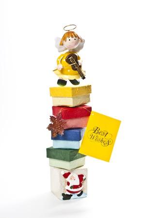 weave ball: Yellow angel on top of gift box Stock Photo