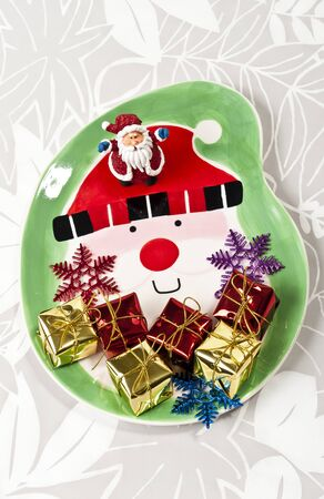 Santa plate with small gifts Stock Photo - 8385412