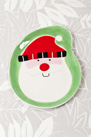 Santa plate on the leaf paper background