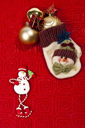 Snow man glove on red paper background Stock Photo - 8387491