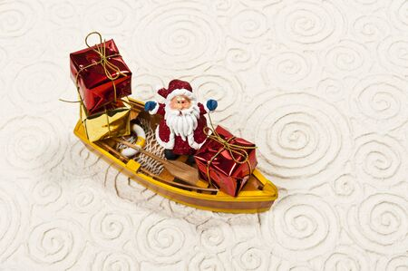 Lonely Santa on the boat with his gifts photo