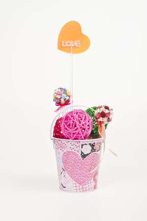 weave ball: Lovely bucket with colorful weave ball and heart symbol notepad Stock Photo