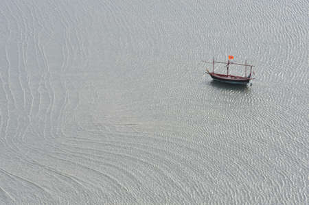 Lonly fishing boat in the sea photo