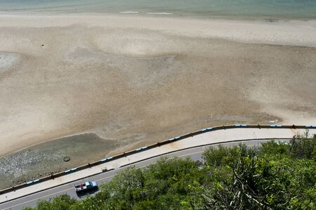 Bird eye view of beach and road Stock Photo