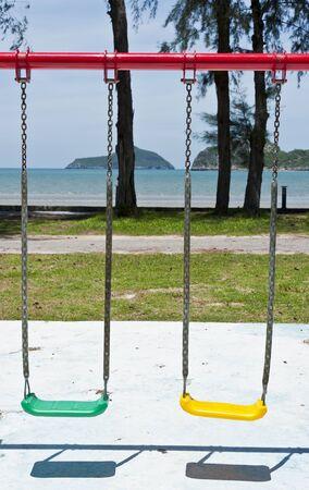 Swing on the playground near the beach