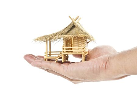 Thai house model in one hand