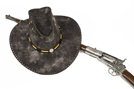 cowboy hat with rifle isolated on white background