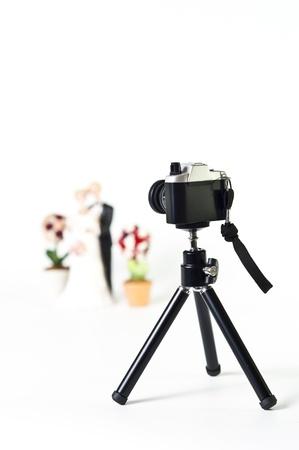 bridegrooms: Film camera on tripod point Wedding couple