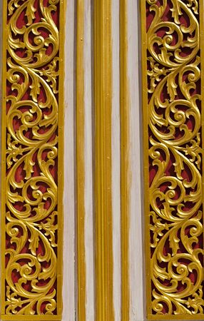decoraton: Wooden Thai style carving on the door of temple