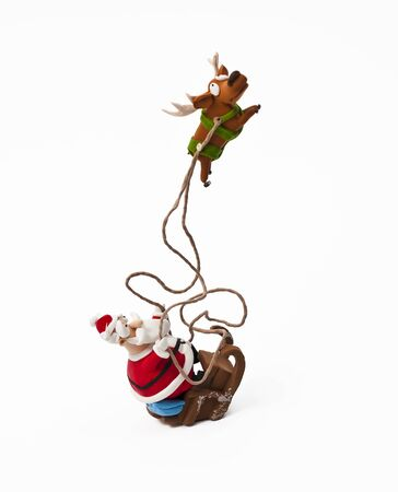 Santa claus riding on sleigh with one reindeer