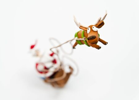 Zoom in reindeer with Santa claus riding on sleigh