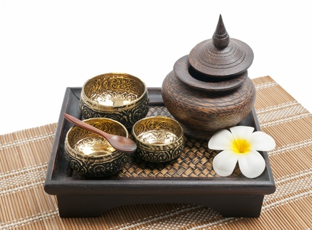 Thai carving brass and wooden bowl in wooden tray photo