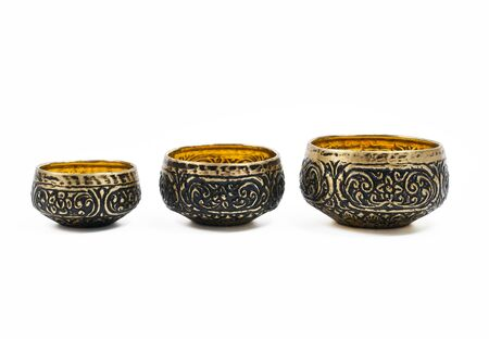 Thai carving brass in different size isolated on white background