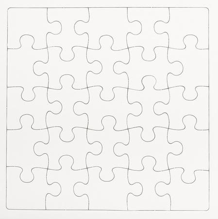 White blank jigsaw isolated on white background Stock Photo