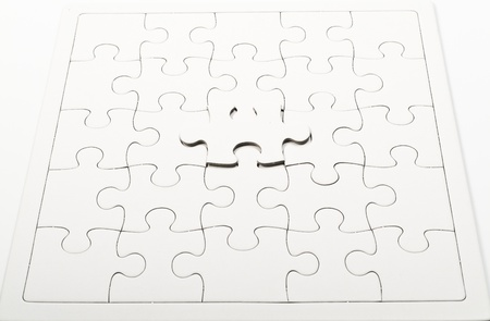 one white jigsaw on jigsaw puzzle pad